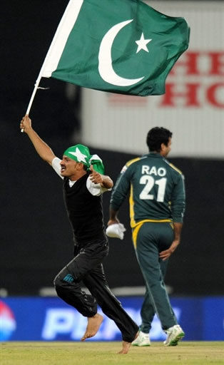 A fan celebrates after Pakistan win over India
