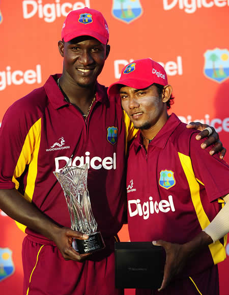 West Indies captain Darren Sammy and Man of the Match Devendra Bishoo pose with the Trophy