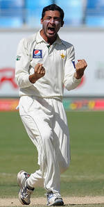 Junaid Khan is pumped up after taking a wicket
