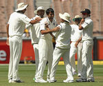 India celebrate Michael Hussey's dismissal