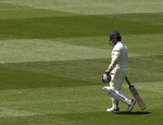 Sachin Tendulkar walks off