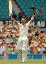 Michael Clarke raises his arms after reaching his hundred