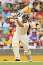 Michael Hussey drives through the off side