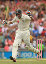 Michael Hussey pumps his fist after getting to a ton