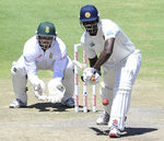 Angelo Mathews presses forward to defend