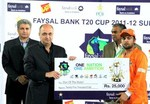 Ahmed Shahzad with the Man of the Match cash Award