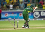 An image showing Saeed Ajmal getting bowled