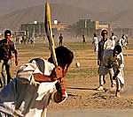 Cricket lovers playing under trying conditions