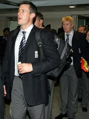 Ashley Giles (L) and Matthew Hoggard (R) arrives at Islamabad International Airport