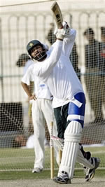 Inzamam-ul-Haq watches the ball after hits a ball during a net practice session at Multan