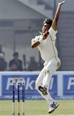 Mohammad Sami delivers a ball