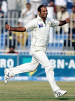 Naved-ul-Hasan celebrates after getting a wicket