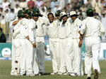 Pakistani cricketers in a huddle