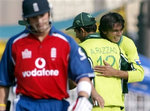 Mohammad Asif celebrates with Abdul Razzaq after taking a wicket